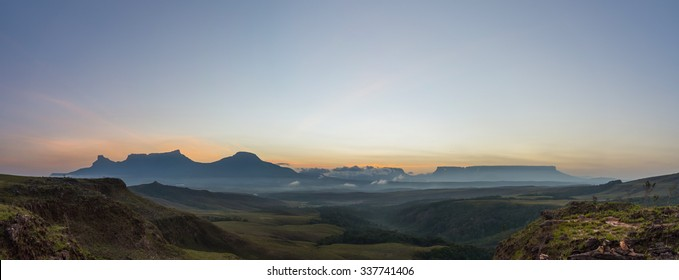 Spectacular view of a sunrise from El Oso viewpoint in the Gran Sabana region, at Canaima National Park, Venezuela. The tepuis (table-top mountains) of the eastern chain are visible on the background.
