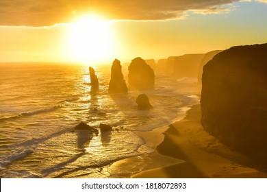 Spectacular view of Twelve Apostles, Great Ocean Road Victoria Australia at golden hour during sunset taken in August