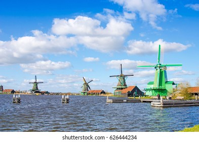 Spectacular view of the water and windmills in Zaanse Schans, Holland, Europe.
