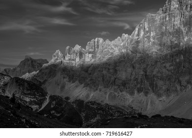 Spectacular views of Civetta mountain range with Civetta summit at its center from the terrace of Tissi refuge at the golden hours before sunset, Dolomites, Alleghe village, Belluno province, Italy