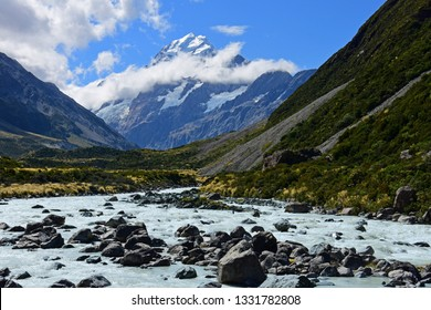 spectacular views of mount cook and the hooker river along the hooker valley track on a summer day in summer,  near mount cook village on the south island of new zealand