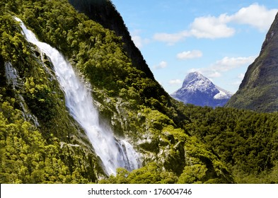 Spectacular waterfall in Milford Sound Fiordland National Park, New Zealand.