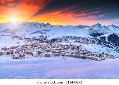 Spectacular winter sunrise landscape and ski resort in French Alps,Alpe D Huez,France,Europe