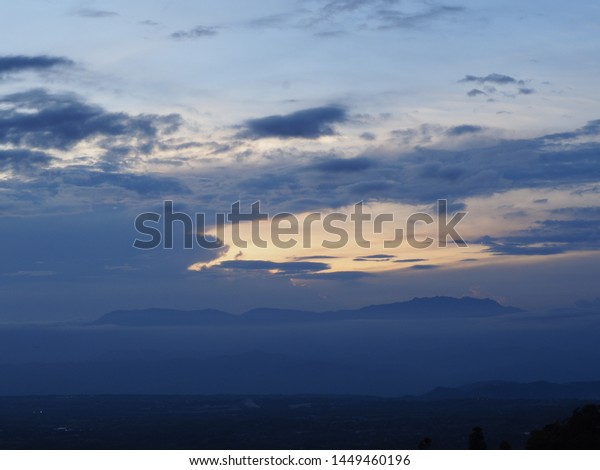 Spectacular Yellow Orange Sunset Clouds Over Stock Photo