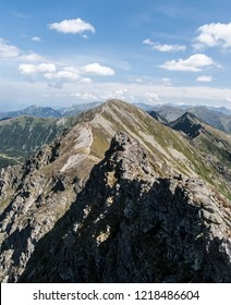 spectaculra Tatra mountains panorama with many peaks from hiking trail bellow Banikov peak on Rohace mountain group in Zapadne Tatry mountains in Slovakia