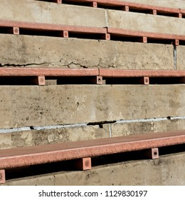 Spectator seating on an old football stand. This image can be used to represent sports at a grassroots level or sports development.