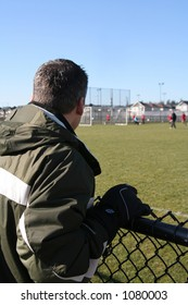 Spectator watching soccer game