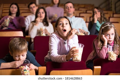 Spectators attending movie night with popcorn in cinema house