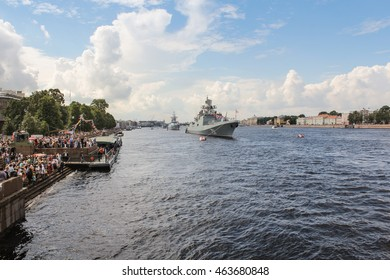 Spectators parade on the promenade. St. Petersburg, Russia - 31 July, 2016. Festive parade of warships on the Neva River in St. Petersburg.