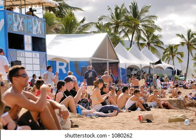 Spectators watch surf competition on Oahu Hawaii's North Shore. (image contains noise)