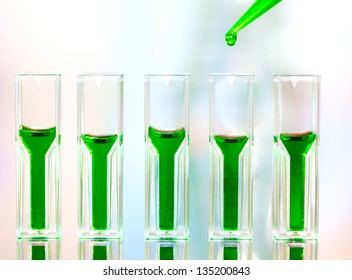 Spectrophotometer quvettes on a reflective surface, copy space
