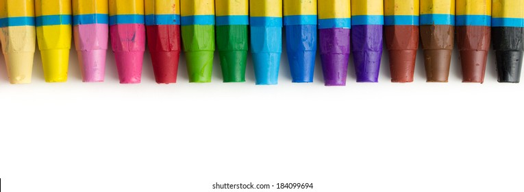 Spectrum of color crayon isolated on white background