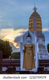The spectrum light background behind the big buddha standing on temple in public temple in Phitsanulok Province ,Thailand
