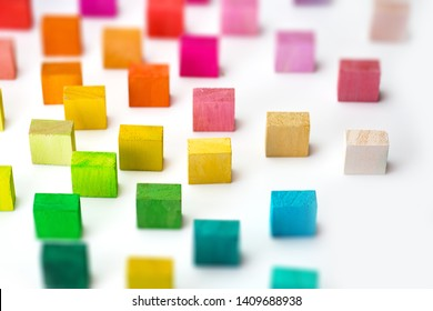 Spectrum of multi colored wooden blocks standing, on white background.  Background image or cover for something creative or diverse.