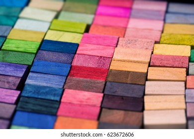 Spectrum of multi colored wooden blocks aligned. Background or cover for something creative or diverse.?Intentionally shot with extremely shallow depth of field.