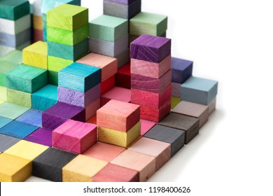 Spectrum of stacked multi-colored wooden blocks. Background or cover for something creative, diverse, expanding,  rising or growing. On pure white.