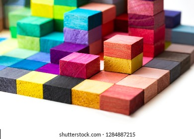Spectrum of stacked multi-colored wooden blocks. Background or cover for something creative, diverse, expanding,  rising or growing.