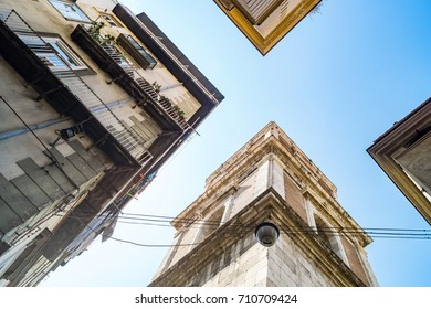 specular view of the bell tower of Santa Chiara church in Naples, italy