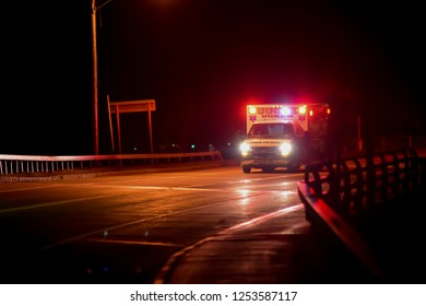 Speculator, NY - November 18, 2018:  The Speculator, NY ambulance racing to a medical emergency at night.