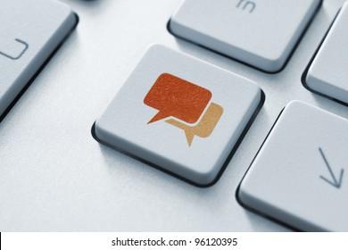 Speech bubble key button on the keyboard. Toned Image.