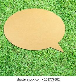Speech Bubble on green grass background