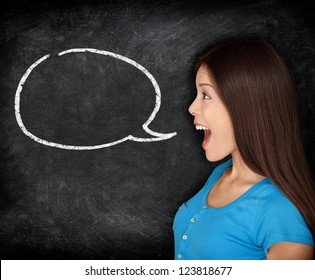 Speech bubble woman student blackboard. Woman talking in profile with black chalkboard texture as background. Funny image of mixed race female college student.