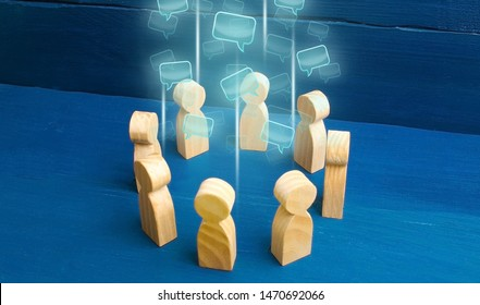 Speech clouds in the center of a people circle. Discussion processes in a team or community. Share opinion, diplomacy. Collaboration and cooperation, participation in a meeting. Business negotiations.