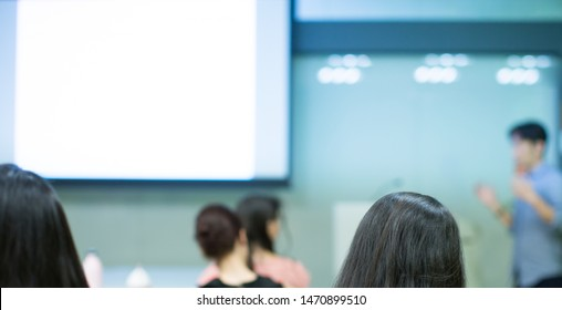 Speech given by professional speaker on stage at corporate conference. Executive manager giving presentation  to audience at leadership workshop for entrepreneurs. Business presenter gives education.