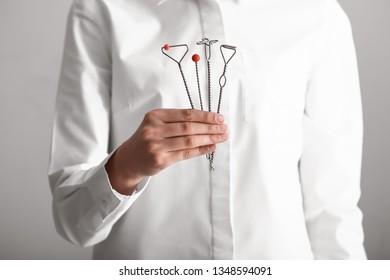 Speech therapist with logopedic probes, closeup
