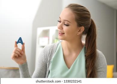 Speech therapist in office