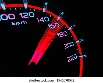At a speed of 150 to 170 kilometers per hour of High lifters truck on car dashboard.Concept Driving fast is dangerous.​ Colorful​ on​ dangerous.