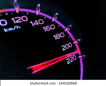 At a speed of 210 kilometers per hour of High lifters truck on car dashboard.Concept Driving fast is dangerous.​ Colorful​ on​ dangerous.