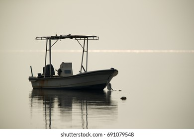 A Speed boat anchored at sea shore of Asker, Bahrain