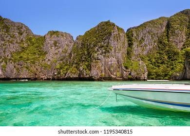 Speed boat and cliffs in the background at Maya Bay, Phi Phi Islands