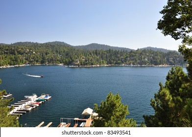 A speed boat cruises around beautiful Lake Arrowhead in the San Bernardino mountains of California.