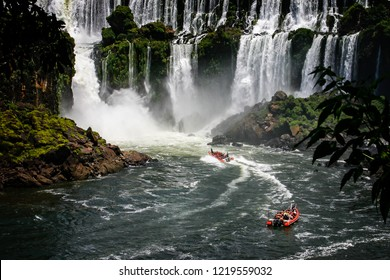 Speed boat rides under the water cascading over the Iguacu falls in Brazil