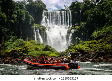 Speed boat rides under the water cascading over the Iguacu falls in Iguacu, Brazil on 18 February 2008