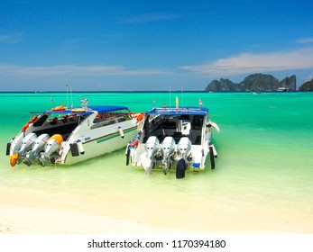 speed boats with crystal clear water in sunny day at Phi Phi island, Thailand