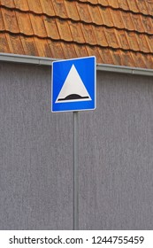 Speed bump road traffic sign at pole