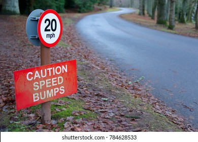 Speed Bumps Caution 20 mph Sign in Rural Countryside Estate