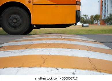 The speed bumps on the road and the bus