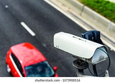 Speed camera monitoring traffic on UK Motorway