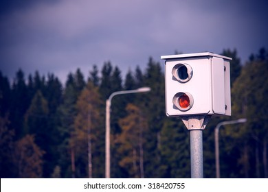 Speed camera on the road in Finland. Image includes a effect.