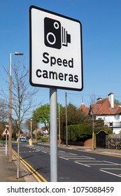 A Speed Cameras sign on a British road.