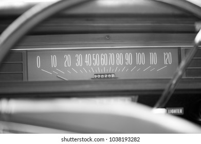 the speed control panel in a retro car, closeup in b&w