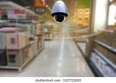 A speed dome CCTV  infrared camera  technology 4.0 for look security area of people at shopping mall show signage with checking movement people in security area.