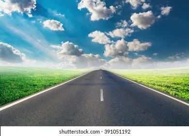 speed highway through the field. asphalt-paved road