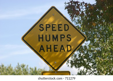 Speed hump sign in the shade