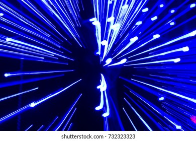 Speed of light - blue traces from points of light in space.