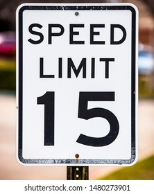 Speed Limit 15 mph sign isolated on a white background.